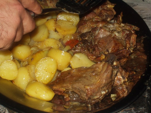 Meats and potatoes slowly roasted over the coals...DELICIOUS!